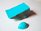 Picture of rough blue Turquoise and a turquoise cabochon.