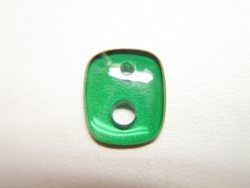 Cushion shape green cabochon with 2 holes of different sizes.