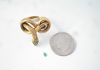 Tiny Jadeite cabochon next to a snake ring.