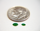 2 tiny marquise shaped green Jadeite cabochons.