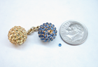 Photo or a very small round sapphire cabochon.
