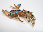 A bird pin with tiny cabochons of Lapis and Turquoise