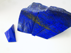 A freeform shaped faceted Lapis cabochon.