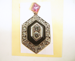 Photo of an Onyx and diamond pendant.