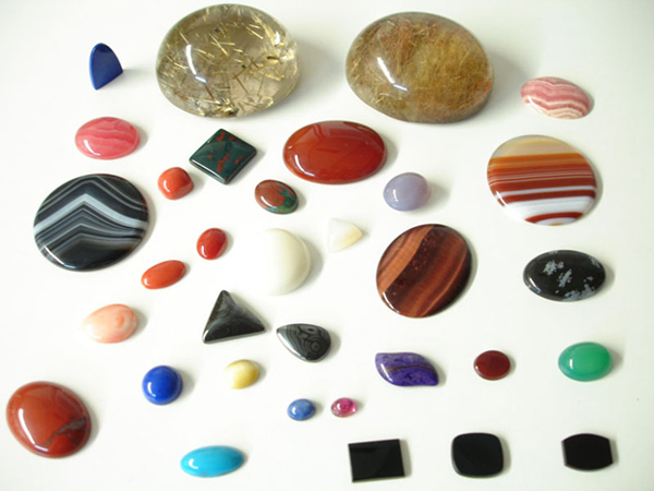 Photo of cabochons of various sizes, colors, and shapes.