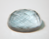Picture of a faceted cabochoon.