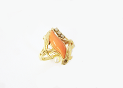 A ladies ring with a marquise shaped pink Coral mounted in the ring.