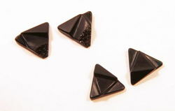 Triangular shapes of carved black Onyx.