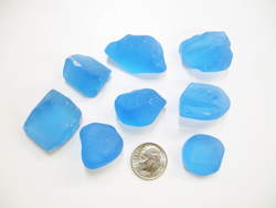 Several pieces of rough blue Topaz material.