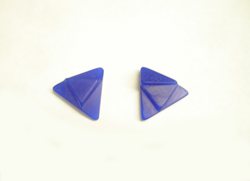 Carved blue wax carved into Triangular shapes as samples to carve Black Onyx like them.