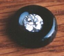 A round blakc onyx with a diamond in the middle