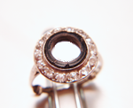 Photo of a ring broken round black Onyx with a large hole in the middle.
