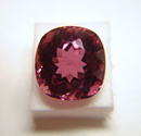 Picture of a cushion pink Tourmaline which is windowed.