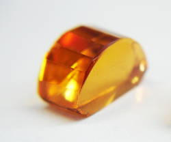 Photo of a yellow-orange Madiera Citrine with an arch shape.
