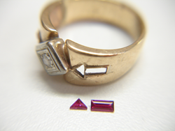 Shows the finished tiny Rubies sitting next to the ring they will be mounted into.