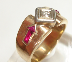 A gold ring with 2 chipped Rubies