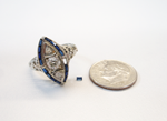An antique diamond ring with tiny blue Sapphires.