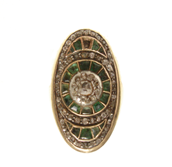 Shows the oval antique ring with dark gren stones and one missing.