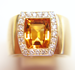 Photo of a yellow gem in a ring.