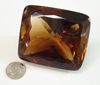 Small photo of a large 850 carat faceted gemstone.