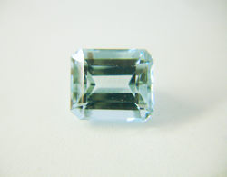 Shows the emerald cut Aquamarine before re-faceting.