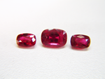 Photo of 3 cushion shaped Rubies.