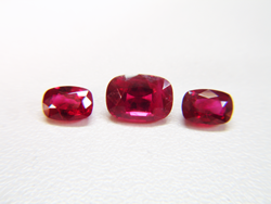 Shows all 3 cushion Rubies