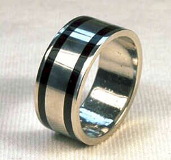 A platinum ring band inlaid 360° with 2 Black Jade inlays.