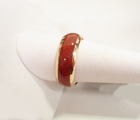 An 18 karat gold band inlaid 360 degrees around with petrified Dinosaur bone.