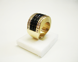 Shows the finished ring with the black jade inlay which has grooves carved into it.