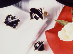 Photo of cufflinks and tux studs which have black Jade inlays and princess cut diamonds which slide in channels.