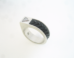 Teh finished ring with a trillion diamond and the carved Black Jade inlay.