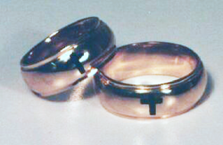 2 rings which have been inlaid with black Onyx in the shape of crosses.