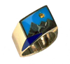 Small photo of a ring with a mountain scene inlaid with Lapis and Turquoise and a yellow Sapphire for the sun.