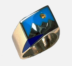 Inlay ring with a lake area which is inlaid with blue Lapis, a sky area made of Turquoise and a yellow Sapphire for a sun.
