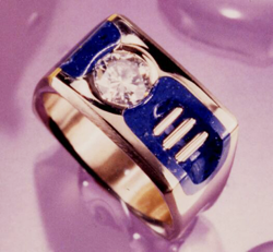 Ring with a diamond and Lapis on both sides of the Diamond.