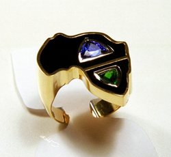 Ring shaped like Africa inlaid with Black Jade also containing a blue Tanzanit and a green Tsavorite.