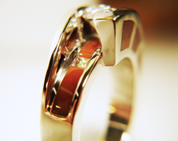 Photo of the finished diamond ring with Jasper inlays on the sides of the ring and also under the diamond.