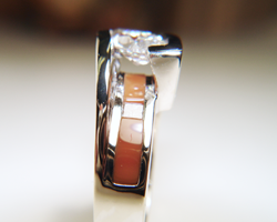 Ring showing a Jasper inlay under the marquise diamond.
