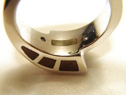Photo showing the inside of the shank of the ring which is also inlaid so that the inlay will touch the finger.