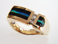 Photo of a gold ring with Opal and black Onyx inlay.