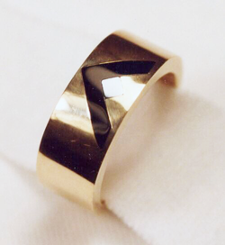 A men's band inlaid with a V shape of Black Jade and a small silvery square of Silicon.