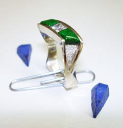 Shows the ring with the Jadeite glued in place and the unfinished Lapis pieces.