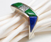 Photo of a white gold ring with blue Lapis and green Maw Sit Sit Jade inlays.