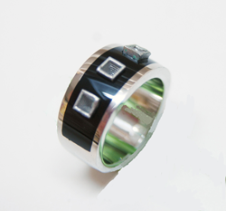 This photo shows the finished ring with the 3 square tubes sitting in the Black Jade inlay.
