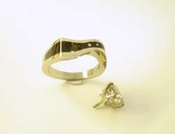 Photo shows the finished ring with the Diamond next to it.