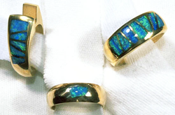 3 rings inlaid with numerous Opal inlays.