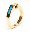 A simple ring with a long Opal inlay going down each side.