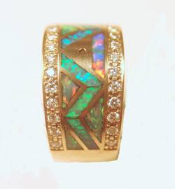 A ring with many small Opal inlays. The center row has a zig zag pattern.