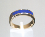 A simple arching inlay of Lapis in a ring.